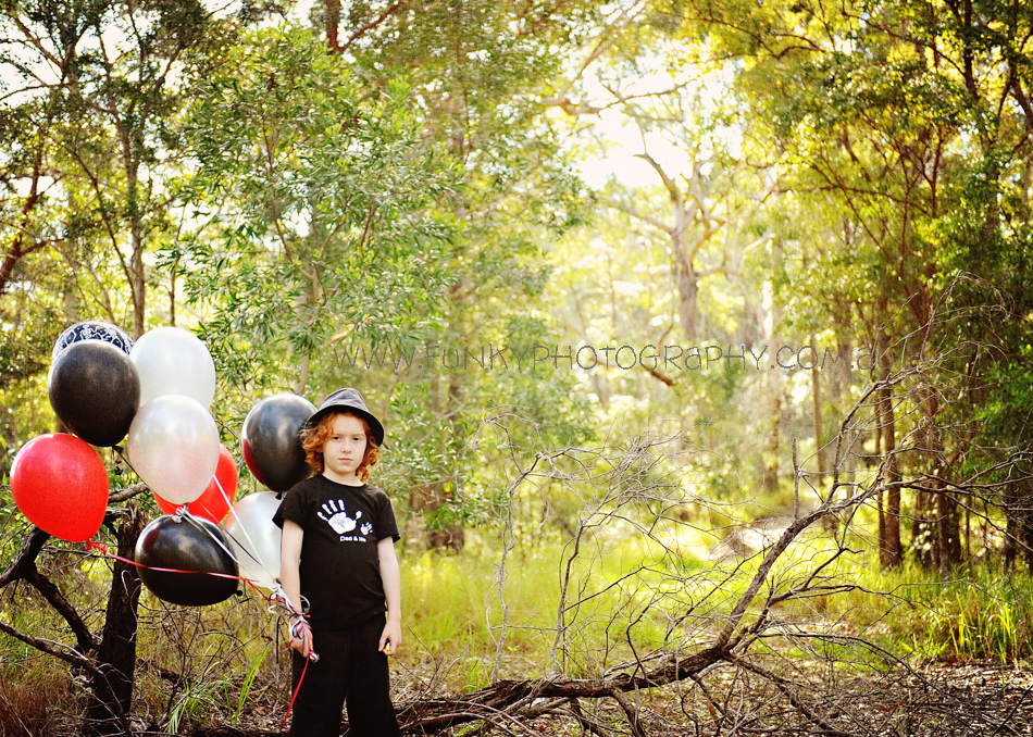 boy with balloons red and black