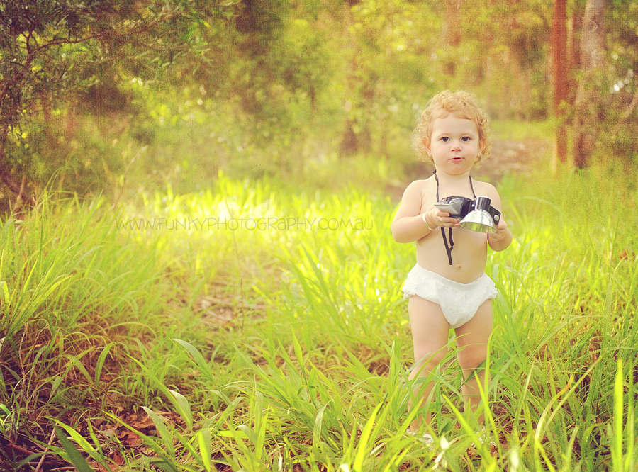 little girl in woods with a vintage camera at noosa