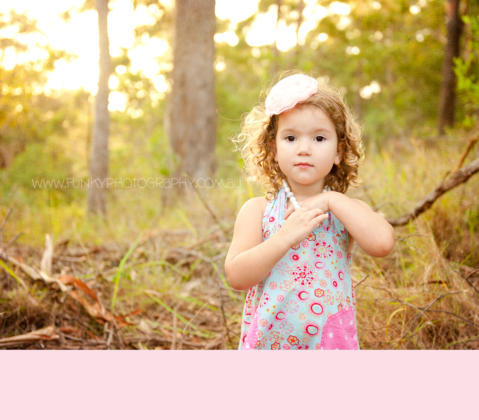 girl in woods with headband on from petite enfants
