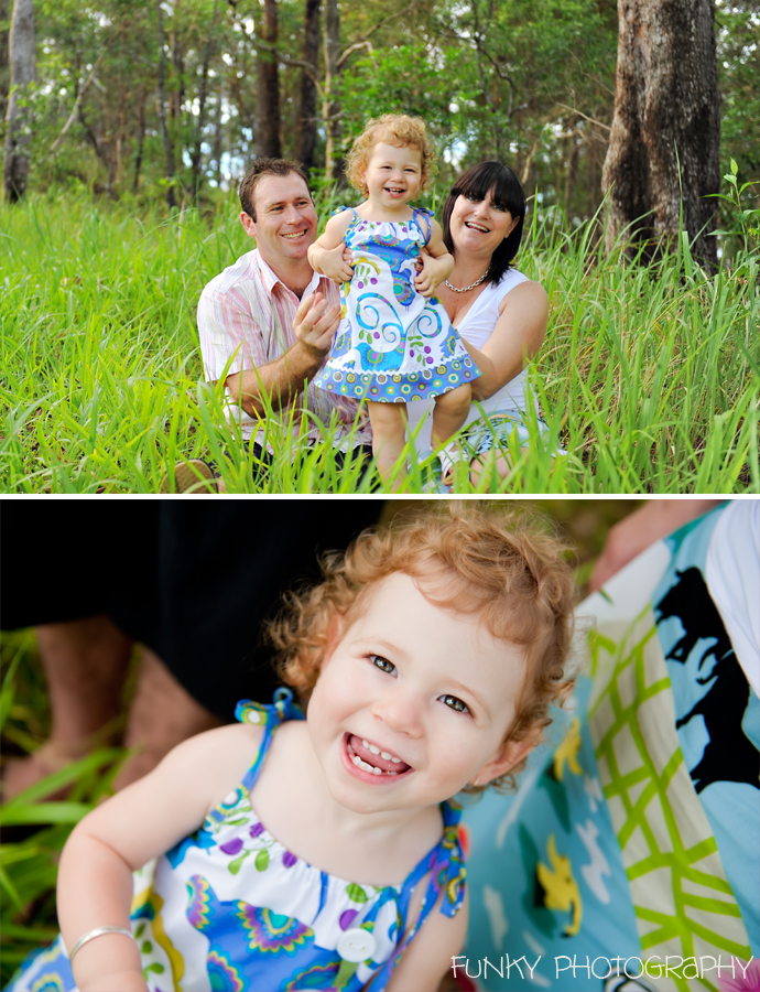 family in woods and long grass toddler smiling
