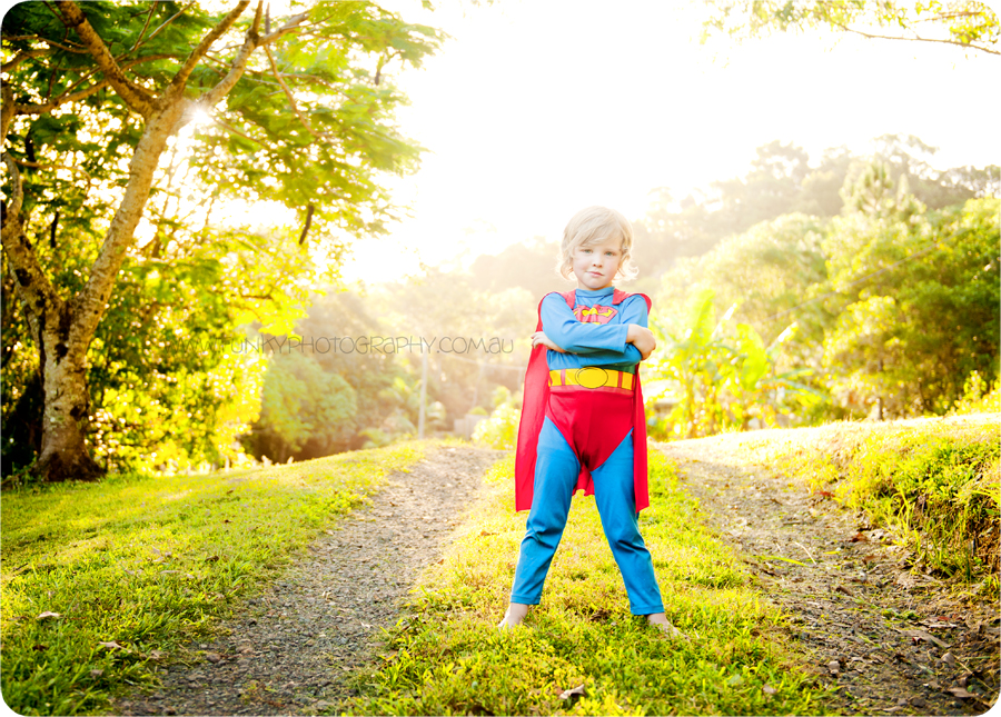image of a boy in a superman outfit with sunflare