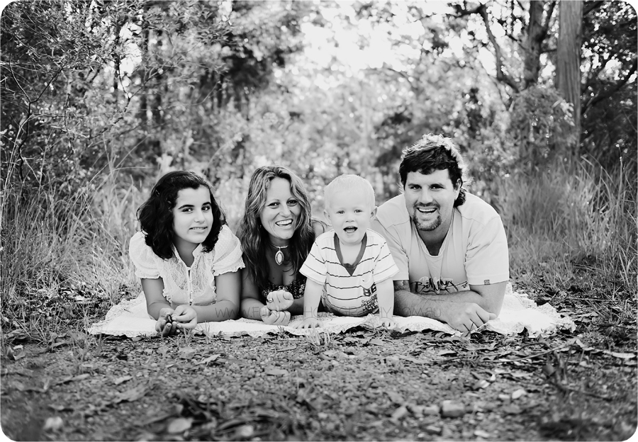 family together on a picnic rug black and white