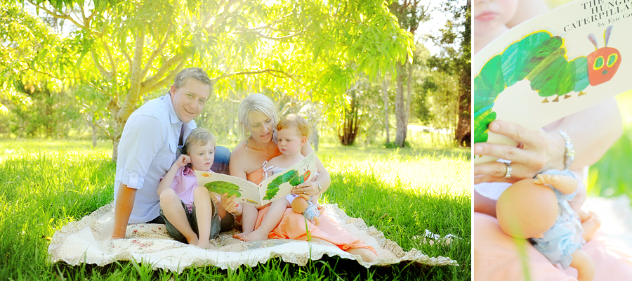 family reading the hungry caterpillar on a picnic rug