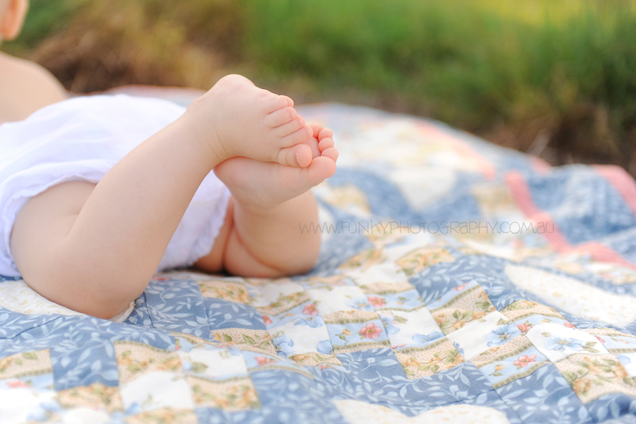 noosa child photography baby on a rug