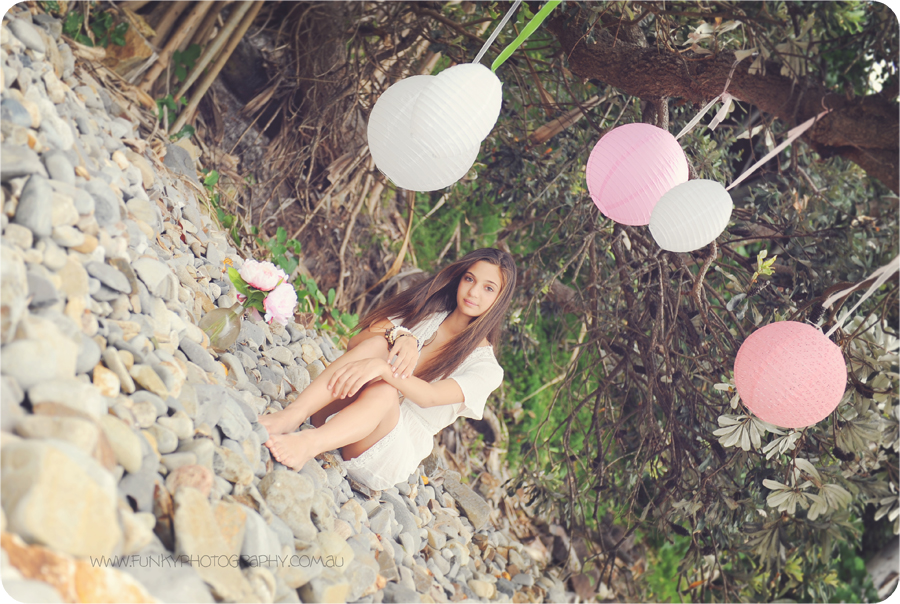 girl at little cove noosa with pink and white lanterns