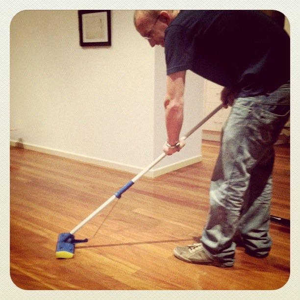 husband mopping the floor
