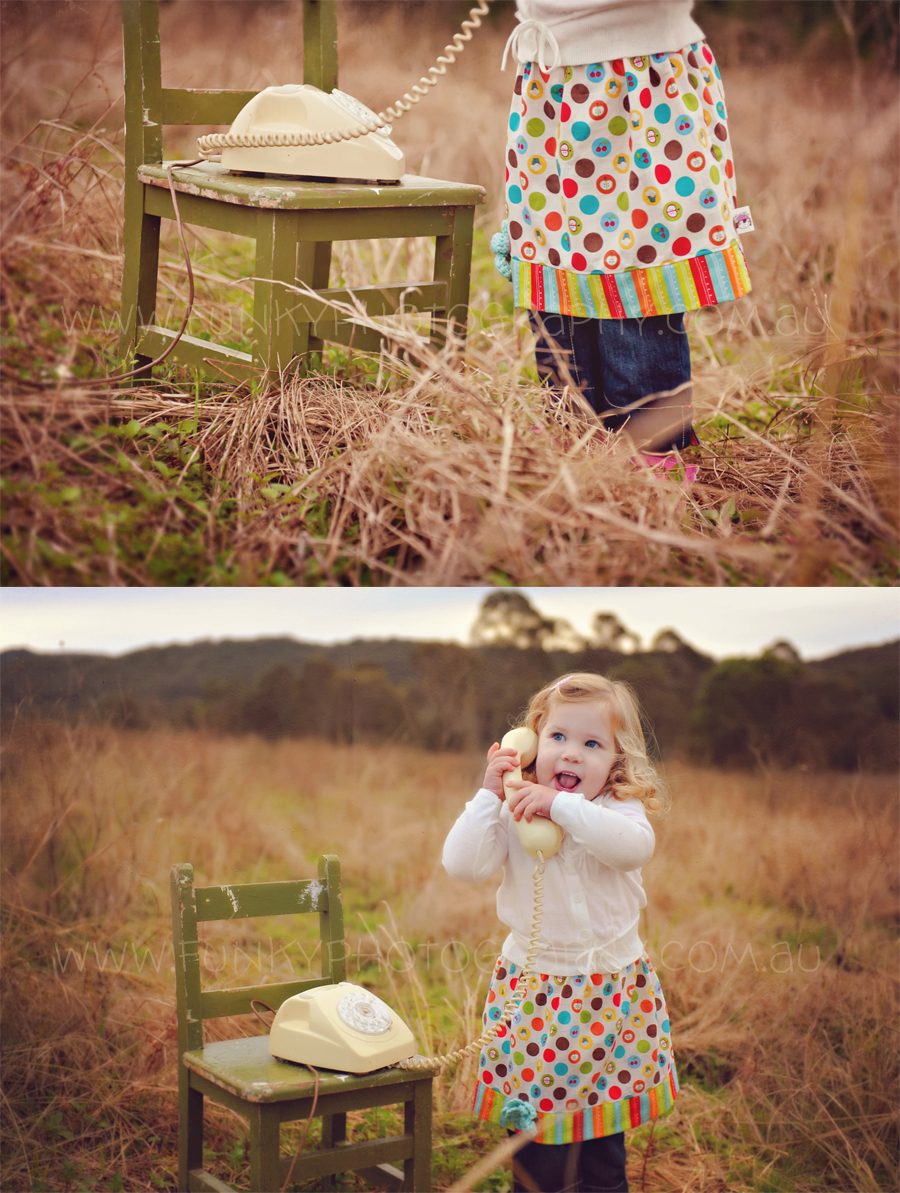girl on a retro rotary telephone in a field wearing a nuxiemade skirt