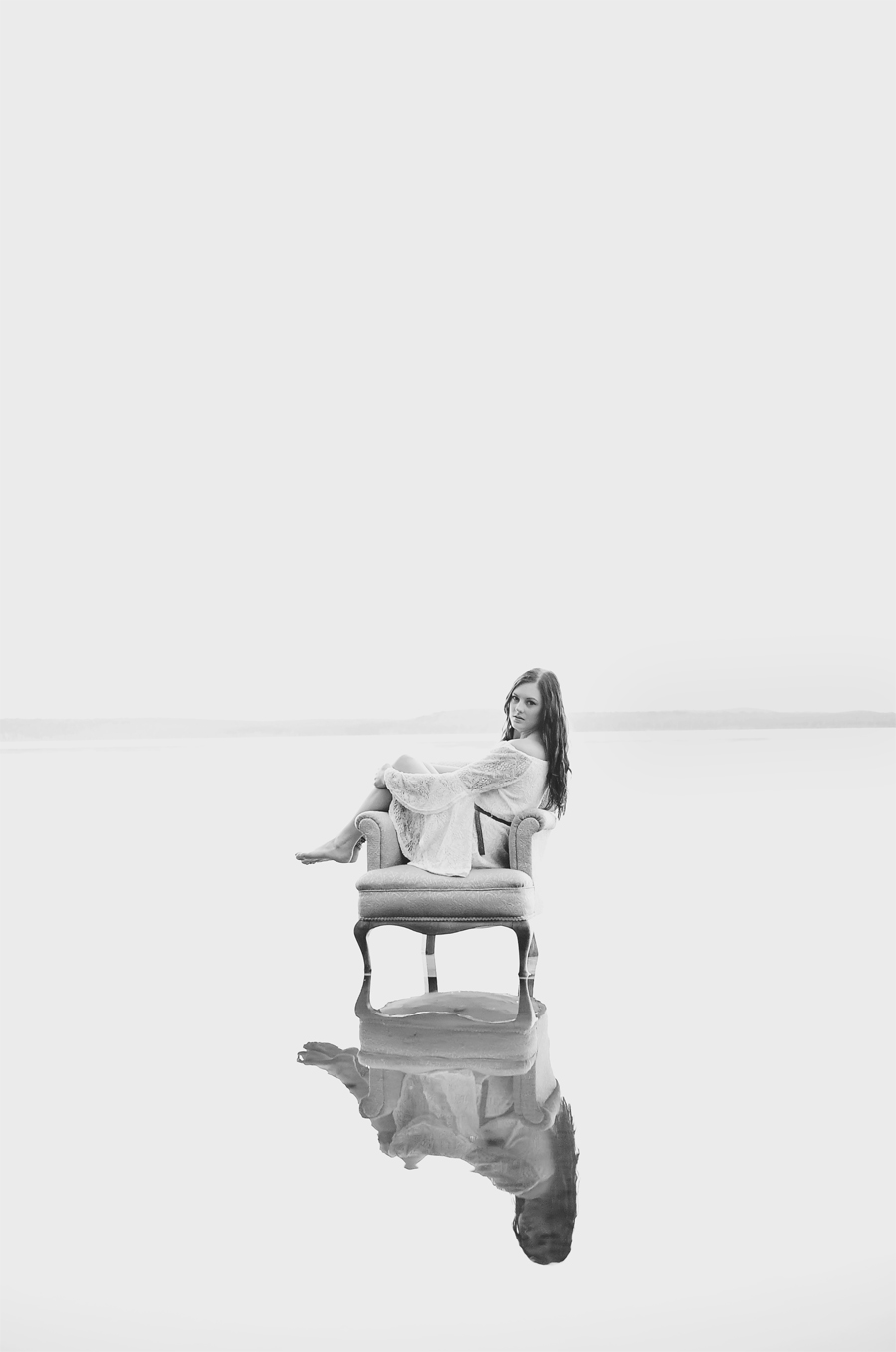 girl in lake on a chair